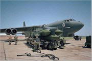 Six unarmed Advanced Cruise Missiles (ACM) are loaded onto a B-52H bomber at Barksdale Air Force Base in Louisiana.